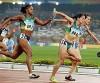 Revezamento entre Lucimar Moura (esq.) e Thaissa Presti nas Olimpíadas de Pequim.